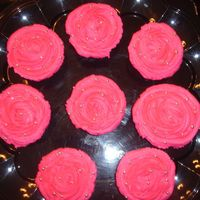 Hot Pink Cupcakes   I made 100 of these, had a lot of fun. Hot Pink cupcakes, with silver drages, and clear gold