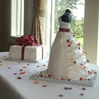 Bridal Shower Dress Cake Or Bridal Dress Cake With Autumn Or Fall Leaves And Edible Pearls; And Matching Present Cake Bridal shower dress cake is 4 round cake layers (one 10 inch, two 8 inch, one 6 inch) and bodice is black fondant covered rice krispy...