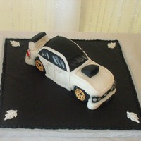 Grooms Car Cake This grooms car cake was really rice krispy treats covered with fondant. it was 9-10 inches long and way too small to carve out of cake.