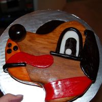 Dopey Dog I made this for a childrens home auction. If anyone knows the best way to store a fondant covered cake please let me know. The auction isn...