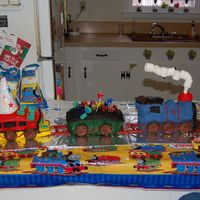 Finished Pic this is the finished product. i made it for my nephews 3rd birthday. he loves trains and even told me how he wanted it decorated.