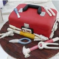 A Man's Cake This cake was covered with MMF and all tools were made from chocolate