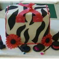 Purse Cake This was my second purse cake. It was inspired by a few CC member's cakes. I had so much fun doing this cake.
