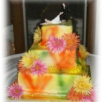 Tie-Dye This was one of my funnest cakes yet. It is tie-dye air brushed buttercream with real gerbera daisies.