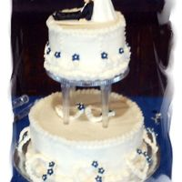 Based On Original Wilton Course 3 Cake The bride saw my course 3 cake on my site and wanted it duplicated only with navy flowers. I like this version better.