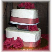 Red And White Hearts This was for a Feb. wedding. I used an impression mat on the sides. I also used a glass heart dish filled with rose petals between the...