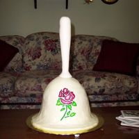 Decorative Bell My mom collects bells and so I made her this 3-D bell cake. I used the wonder mold and a 12 inch round. The handle is molded on a dowel rod...