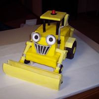 Scoop From Bob The Builder View 1 Of 3  Cake covered in MMF, tires covered in chocolate clay, and front loader and back hoe are made of gum paste. Took me a week to make of the...