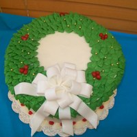 Christmas Wreath All cream cheese icing with a fondant bow dusted with luster dust.