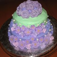 Green And Purple Tiered Cake Vanilla with vanilla cake. Handmade pearls with royal icing flowers.