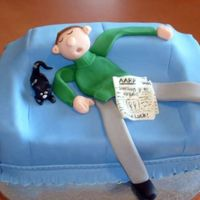 Retirement Cake The guest of honor sitting on his couch with his cat sound asleep. Basically how we all know he will pass the time now that his is retired...