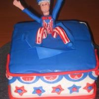 July 4Th Cake Vanilla cake with praline crunch filling. Decorations are fondant, gumpaste, and royal icing.