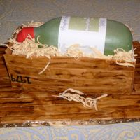 Wine Bottle Crate Cake is carved and stacked and covered in fondant. Wood crate is handpainted. Label is edible image.