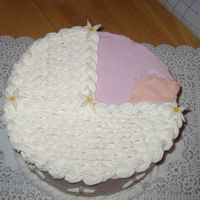 Wilton Baby Shower Variation Chocolate cake, all buttercream with MMF flowers and foot.
