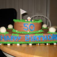 Over The Hill Golf Cake chocolate cake with chocolate buttercream icing. Fondant golf balls.I can't remember who the idea came from on the board, but mant...