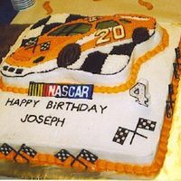 Tony Stewart #20 Cake This was done with the Wilton race car pan the numbers and race flags are colorflow as well as the nascar logo