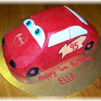 Lightning Mcqueen choc cake with bc icing and fondant accents. The red icing went a bit funny as it dried, like spotty, I wont use powder again I will use a...