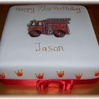 21St Cake Choc mud cake, picture is laminated and flames were piped on and coloured. It was for a firefighter.