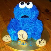 Cookie Monster My very first 3d cookie cake. I was pretty happy. I used rice crispies for the arms and legs and skewered them in. One arm half fell off so...