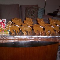 Santa And His Reindeer Santa and his reindeer made entirely of gingerbread dough. Takes some time as they were hand cut but my grandchildren loved it.