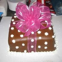 Pretty Package really simple package cake. buttercream and MMF with fabric bow