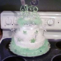 Sweet 15 I made this for my daughters 15th bday. All white frosting with white and lime boas, white ribbon, and the stars are sour apple airheads.