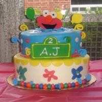 "Elmo Cake 10"" WASC and 8"" Chocolate covered in MMF."