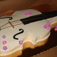 Sweet Violin All WASC cut into shape of a violin. The girl who the cake was for requested it be white with pink and purple flowers so here it is. It...