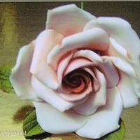 Pink Rose Gumpaste rose, shadowed and highlighted with powdered color.
