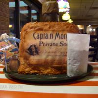 Oh, Captain, My Captain!  This is my first sculpted cake, which I made for my nephew's twenty-first birthday. I had to replicate the shape of a Captain Morgan...