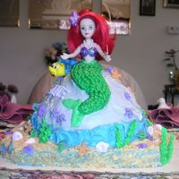 My Little Mermaid   Flounder is made of fondant. Seashells and seaweed are Royal Icing. Everything is edible except torso up on the mermaid.