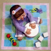 Baby At Play Everything is edible. Baby is sculpted and covered in Fondant. Blocks are also cake covered in Fondant. Toys & Quilt are Fondant.
