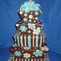 Tapered Squares Tapered square cakes covered in brown fondant and decorated with sky blue, turquoise, and ivory. The bow is marbled with the three colors I...