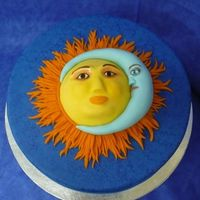 Sun & Moon Sun and moon are made from fondant and placed on a 12in round cake iced in blue then sponge painted with blue airbrush color.