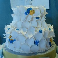 Shabby Chic The bride called me the week before her wedding and asked for a cake with royal blue and yellow. She let me come up with the design. I just...