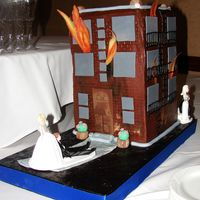 Burning Building I love to do fun groom's cakes. This groom is a fireman. We decided on a burning building with the bride pulling the groom away. I...