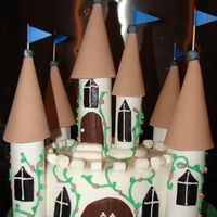 Castle White castle with fondant turrets. I donated this cake to my children,s school for a silent auction. I can't wait to see how the...