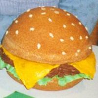 Burger Cake used the wilton ball pan and pound cake recipe from an '86 wilton yearbook. The cake crust looked so realistic I ddidn't cover it...