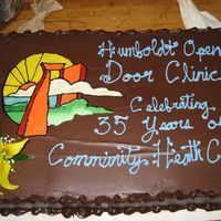 Logo Cake Nothing special. Made at work for a local health care clinic's anniversary. They provided a picture of their logo and I freehanded it...
