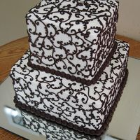 Chocolate Lace Freehand chocolate lace covering cakes. 6, and 9 inch squares. Not sure where the original lace design is from (a bride brought in a...