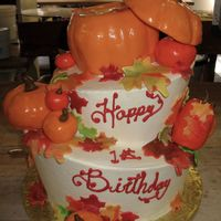 "Pumpkin Patch Mad Hatter Mad Hatter style cake. Top tier pumpkin is carved cake. The top pumpkin ""lid"" and all other pumpkins are hand molded rice crispy..."