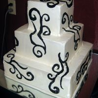 Tribal Cake Cake iced in SMBC, with tribal scroll pattern piped (freehand) randomly all over the cake. Scroll pattern proved by the bride. Summer '...