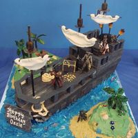 Pirates Ship Pirates of the Carribean. Ship was sculpted and covered in fondant then embellished with various sugar miniatures.