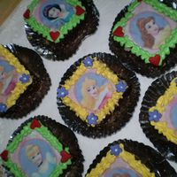Disney Princess Cakes Instead of cupcakes, I do a mini cake top with edible image icing cover with chocolate rasp around. I think it will be easier for the party...