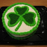 St. Paddy's Day White cake (I died the inside green) w/ buttercream. The shamrock was made with a star tip and green sugar sprinkles.
