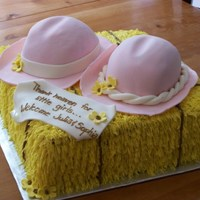 Twin Baby Shower Made for a mother of twin girls who has a farm. Cowboy hats on a hay bale.