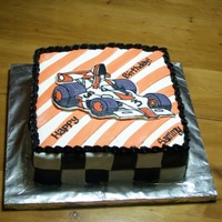 Formula 1 Birthday   Fench vanilla cake with buttercream filling, covered in MMF with FBC transfer of car.