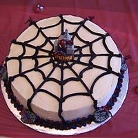 Spider Man Spider Web Cake My son wanted these Wilton Spider Man characters on his cake...so I made a web and put the candle in the middle and a bunch of the Spider...