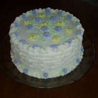 Birthday Cake I did this cake for my Nana's 85th B'day. It is a lemon cake (her fav.) with bc. Her favorite colors are purple and yellow. The...