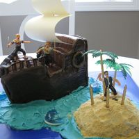 Pirate Ship Birthday Cake Chocolate cake (mix) baked in a 9x11 pan. I cut it into thirds, then stacked and carved it to make the ship-shape.Filled with chocolate...